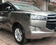 Cần bán lại xe Toyota Innova 2.0E sản xuất năm 2016, màu nâu số sàn giá 700 triệu tại Hà Nội