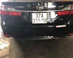 Bán xe Toyota Camry 2.0E sản xuất 2016, màu đen chính chủ giá 870 triệu tại Nghệ An