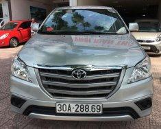 Cần bán gấp Toyota Innova 2.0E năm sản xuất 2014, màu bạc chính chủ giá 590 triệu tại Hà Nội