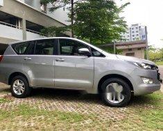 Cần bán lại xe Toyota Innova E đời 2018, màu bạc chính chủ, 910tr giá 910 triệu tại Tp.HCM