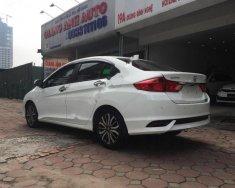 Cần bán lại xe Honda City 1.5TOP sản xuất 2017, màu trắng số tự động  giá 612 triệu tại Hà Nội