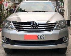 Bán xe Toyota Fortuner AT đời 2013, màu bạc giá 745 triệu tại Bình Dương