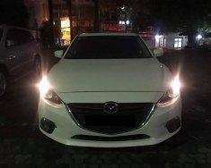 Cần bán xe Mazda 3 Sedan 1.5AT 2015 màu trắng giá 587 triệu tại Tp.HCM