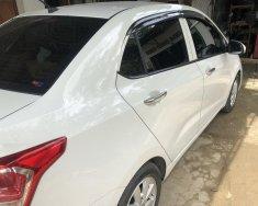 Bán Hyundai Grand i10 sedan 1.2 phiên bản gia đình, đăng ký cuối năm 2016, màu trắng. Xe nhập Ấn Độ, chính chủ giá 390 triệu tại Tp.HCM