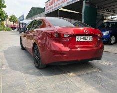 Cần bán Mazda 3 1.5 AT sản xuất năm 2015, màu đỏ giá 598 triệu tại Hà Nội