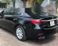 Bán Mazda MX 6 năm sản xuất 2015, màu đen còn mới, giá tốt giá 720 triệu tại Tp.HCM