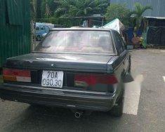 Cần bán xe Nissan Bluebird năm sản xuất 1998, màu xám, nhập khẩu nguyên chiếc, giá 40tr giá 40 triệu tại Tp.HCM