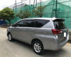 Bán xe Toyota Innova 2.0 E date 06/2017 màu ghi bạc giá 700 triệu tại Tp.HCM