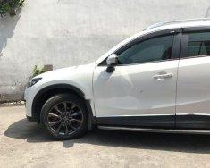 Bán xe Mazda CX 5 sản xuất 2013, màu trắng như mới giá 720 triệu tại Tp.HCM