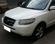 Cần bán xe Hyundai Santafe 2009 máy dầu, số tự động, màu trắng giá 472 triệu tại Tp.HCM