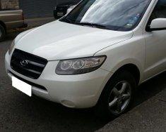Cần bán xe Hyundai Santa Fe 2.0AT sản xuất 2009, màu trắng, nhập khẩu nguyên chiếc giá 472 triệu tại Tp.HCM
