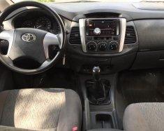 Chính chủ bán Toyota Innova 2.0E năm 2014, màu bạc giá 560 triệu tại Hà Nội