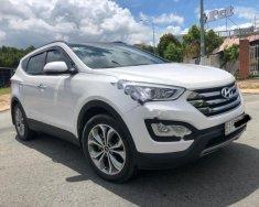 Bán Hyundai Santa Fe 2.4 AT sản xuất 2015, màu trắng giá 939 triệu tại Tp.HCM