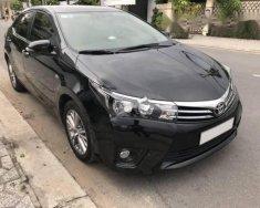 Cần bán gấp Toyota Corolla altis 1.8G AT 2016, màu đen  giá 715 triệu tại Hà Nội
