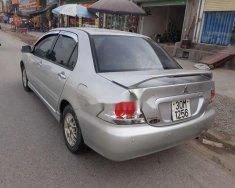 Cần bán lại xe Mitsubishi Lancer đời 2004, màu bạc giá 198 triệu tại Hà Nội
