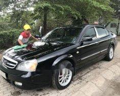Cần bán xe Daewoo Magnus năm sản xuất 2004, màu đen giá 155 triệu tại Tp.HCM