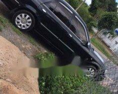 Bán xe Ford Laser sản xuất năm 2004, màu đen giá 215 triệu tại Lâm Đồng