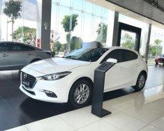 Bán xe Mazda 3 1.5 Hatchback 2018 trắng giá 689 triệu tại Tp.HCM