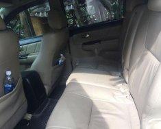 Gia đình cần bán xe Toyota Fortuner V, 12/2014, màu trắng, 49000km giá 750 triệu tại Tp.HCM