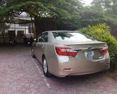 Bán Toyota Camry 2.0 E năm sản xuất 2014, màu vàng   giá Giá thỏa thuận tại Hà Nội