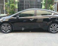 Bán Kia Cerato 1.6AT năm 2016, màu đen  giá 570 triệu tại Tp.HCM