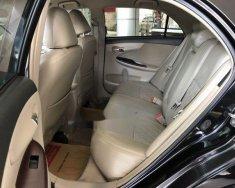 Cần bán lại xe Toyota Corolla altis 1.8MT 2012, màu đen xe gia đình, giá 520tr giá 520 triệu tại Tp.HCM
