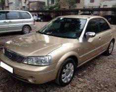 Gia đình cần bán Ford Laser 1.8 Sx 2005, số sàn, màu vàng cát còn mới giá 237 triệu tại Tp.HCM