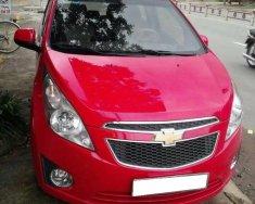 Cần bán chiếc Chevrolet Spark LT MT sx 2013, màu đỏ giá 198 triệu tại Tp.HCM