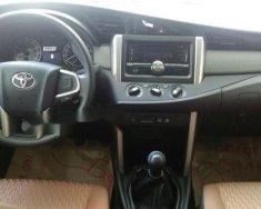 Bán Toyota Innova 2.0E năm sản xuất 2015, màu xám, giá tốt giá 710 triệu tại Tp.HCM