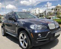 BMW X5 7 chỗ, sx 2009 nhập đức loại cao cấp hàng full. Màu xám xanh, xe có đủ đồ giá 725 triệu tại Tp.HCM