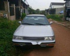 Đổi xe 7 chỗ nên bán xe Toyota Corona đời 1989, màu bạc giá 68 triệu tại Bình Phước