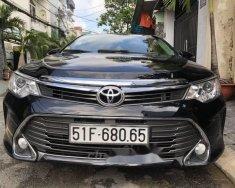 Cần bán Toyota Camry 2016, màu đen, giá tốt giá 930 triệu tại Tp.HCM