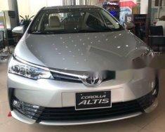 Bán Toyota Corolla Altis 1.8 MT sản xuất 2018, màu bạc, 653 triệu giá 653 triệu tại Tp.HCM
