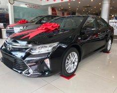 Cần bán xe Toyota Camry màu đen, nhiều ưu đãi cực khủng giá 1 tỷ 300 tr tại Tp.HCM
