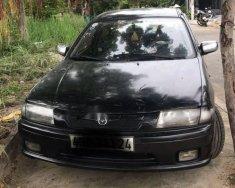 Bán Mazda 323 sản xuất 1997, màu đen giá 100 triệu tại Đà Nẵng