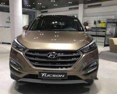 Cần bán xe Hyundai Tucson đời 2018, màu vàng giá 885 triệu tại Bình Dương