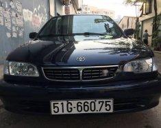 Bán xe Toyota Corolla 1.6 GLI đời 2000 màu xanh đen giá 220 triệu tại Tp.HCM