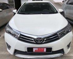 Bán xe Altis 1.8 số tự động, sản xuất 2015, màu trắng giá 700 triệu tại Tp.HCM