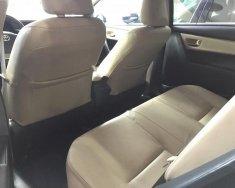 Cần bán gấp Toyota Corolla altis 1.8G AT năm sản xuất 2015, màu đen   giá 675 triệu tại Hải Phòng