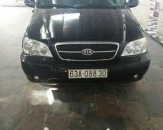 Xe Kia Carnival MT năm sản xuất 2008, màu đen  giá 289 triệu tại Tiền Giang