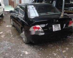 Cần bán lại xe Mitsubishi Lancer 2003, màu đen giá 215 triệu tại Tp.HCM