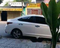 Cần bán xe Hyundai Accent đời 2018, màu trắng, giá tốt giá 580 triệu tại Bình Dương