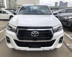 Bán ô tô Toyota Hilux 2.8 AT năm sản xuất 2018, màu trắng, nhập khẩu Thái Lan giá 878 triệu tại Tp.HCM