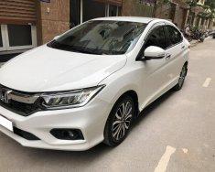 Cần bán Honda City 2017 bản Top màu trắng, chạy lướt giá 595 triệu tại Tp.HCM