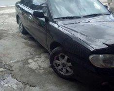 Cần bán xe cũ Kia Spectra 1.6 MT sản xuất năm 2005, màu đen giá 124 triệu tại Nghệ An