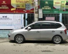 Bán Kia Carens 2010 tự động, màu bạc, xe đẹp còn zin giá 335 triệu tại Tp.HCM