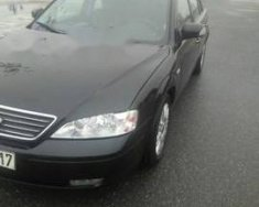 Cần bán Ford Mondeo 2003, màu đen, số sàn, 168 triệu giá 168 triệu tại Bình Phước