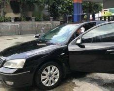 Bán ô tô Ford Mondeo AT đời 2004, màu đen, máy êm ru giá 218 triệu tại Tp.HCM