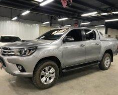 Cần bán Toyota Hilux 3.0 4x4 AT đời 2016, màu bạc, nhập khẩu giá 780 triệu tại Tp.HCM