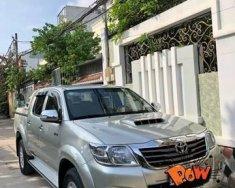 Bán Toyota Hilux 2.5 MT sản xuất năm 2013, màu bạc số sàn giá 490 triệu tại Tp.HCM
